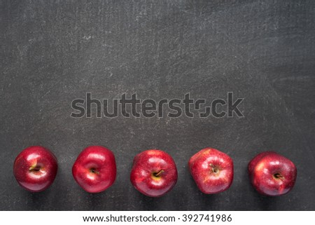 Five apples on painted board