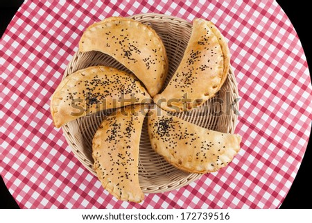 Five bakery in basket on table upper view - stock photo