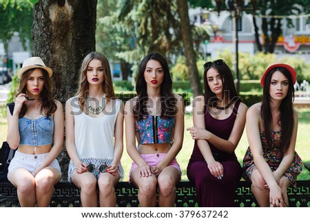five beautiful young girls posing in the park