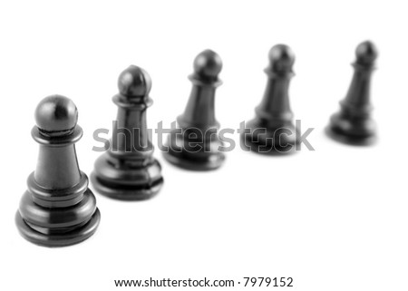 five black chess pawns