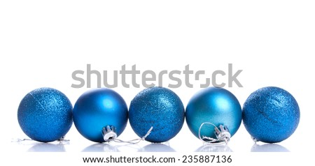 Five blue christmas decoration ball on a white background with space for text - stock photo