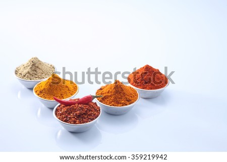 five bowls of spices powder on the white background