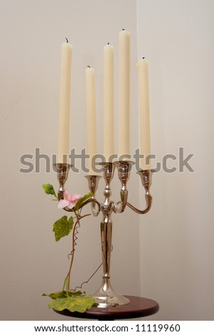 Five buring candles on a silver candleholder - stock photo