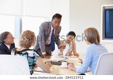 Five Businesspeople Having Meeting In Boardroom