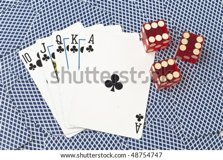 Five cards and three dice, showing a royal flush with clubs from ten to ace, on a background of backsides of blue playing cards. The dice all show number six
