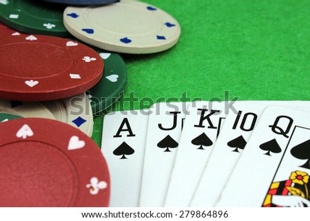 Five cards of the same suit and poker chips