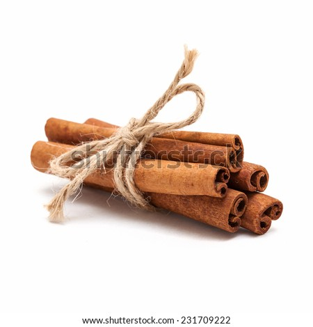 Five cinnamon sticks tied by rope isolated on white background. - stock photo