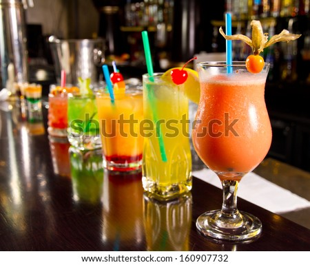 Five cocktails on the bar counter - stock photo