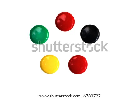 Five colored round magnets isolated on white