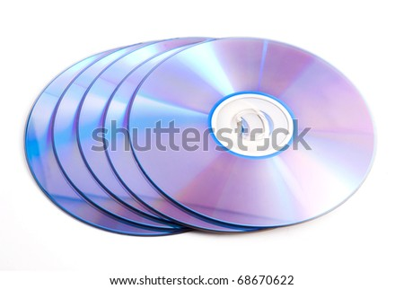 five compact discs on a white background - stock photo
