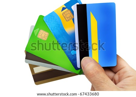 five credit cards in a fingers - stock photo