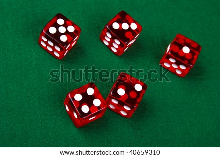 Five dice on a green background