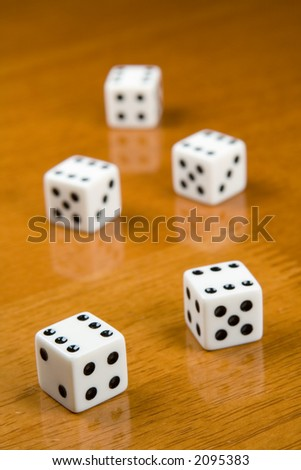 five dices on a table - stock photo