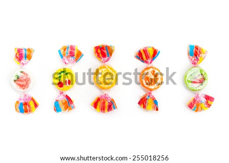 five different candies on white