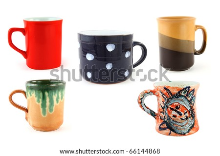 Five different mugs isolated on a white background - stock photo