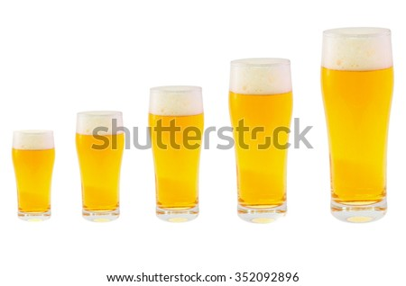 Five different sized glasses filled with cold beer.