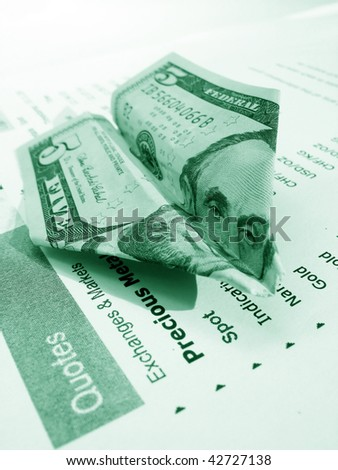 Five dollar airplane on a financial report - stock photo