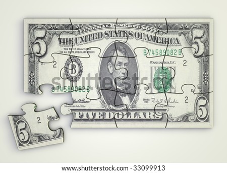 five dollar note as a puzzle - one piece separately - top view - stock photo