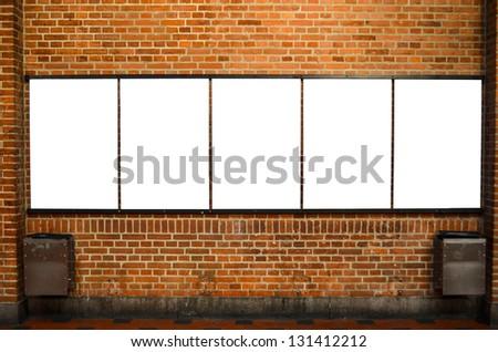 Five empty billboards on brick wall - stock photo