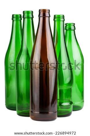 Five empty bottles without labels isolated on white background