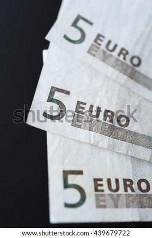 Five euro on black background