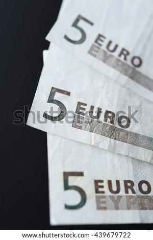 Five euro on black background - stock photo