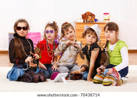 Five fashionable little girls with stylish accessories on - stock photo