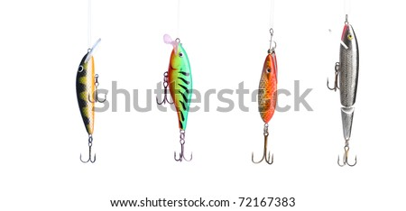 Five fishing lures -floating wobblers hanging in front of white background - stock photo