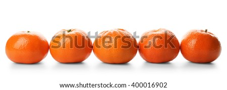 Five fresh tangerines isolated on white background, close up - stock photo