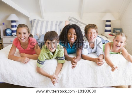 five friends together on bed - stock photo