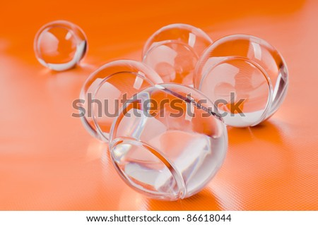 five glass ball on an orange background - stock photo