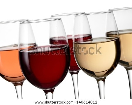 Five glasses with red, white and rose wine, close up