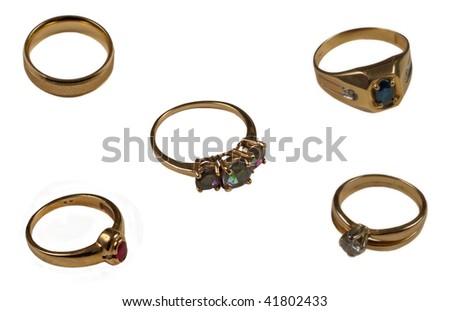 Five gold rings isolated on white