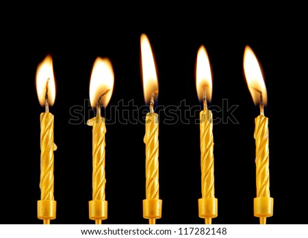 stock-photo-five-golden-burning-candles-