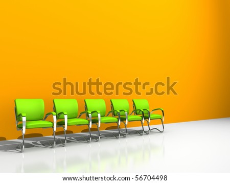 five green chairs against orange wall - stock photo