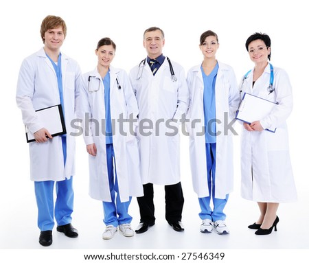 five happy laughing doctors in hospital gown standing together