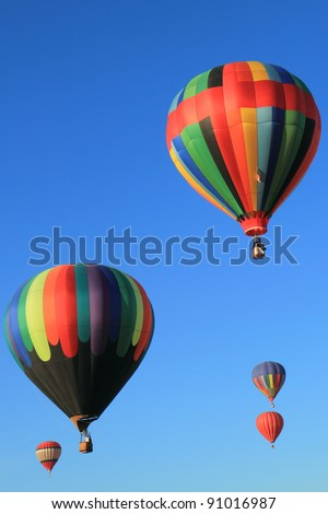 Five hot air balloons in the blue sky