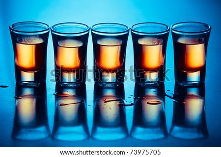 five hot drink shots with reflection in bar - stock photo
