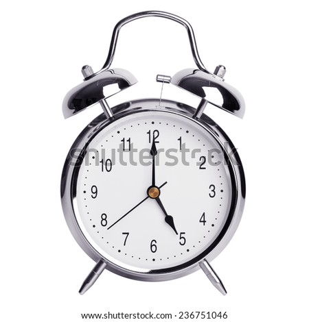 Five hours on a round alarm clock - stock photo