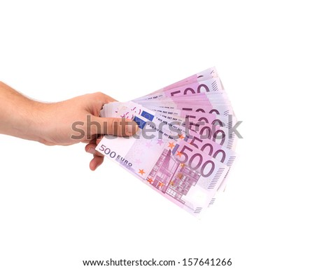 Five hundred bills in hand. Isolated on a white background.