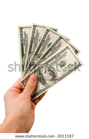 Five hundred dollars in the hand isolated over white