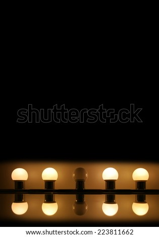 Five light bulbs (four are on; one is out)
