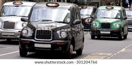 Five London Taxi Cabs in Canary Wharf (licence plate numbers removed) - stock photo