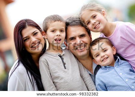 Five member family portrait looking happy - stock photo