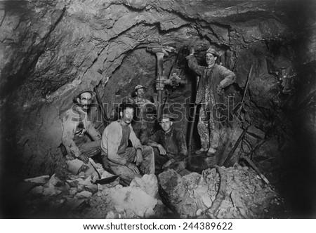 Five miners in Last Chance Company lead mine, in the Coeur d'Alene region of Idaho, Ca. 1910. - stock photo