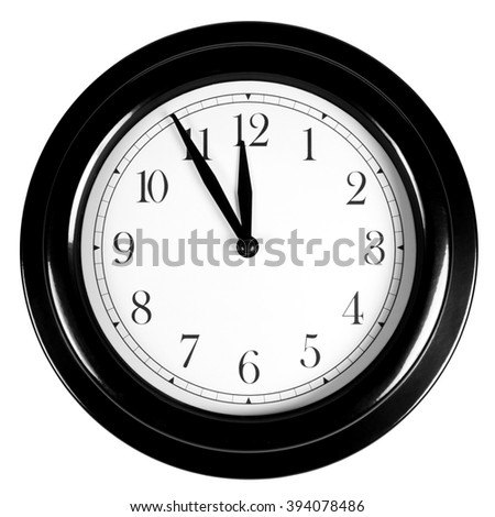 Five minutes to twelve o'clock on wall clock, isolated on white  - stock photo