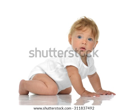 Five month Infant child baby girl lying happy looking back isolated on a white background - stock photo