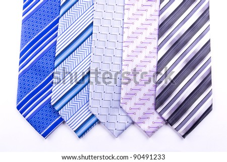 Five multi-colored tie isolated on white - stock photo