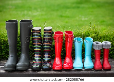 Five pairs of a colorful rain boots. Family concept - stock photo