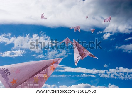 Five paper planes from 500 Euro banknotes fly away in sky